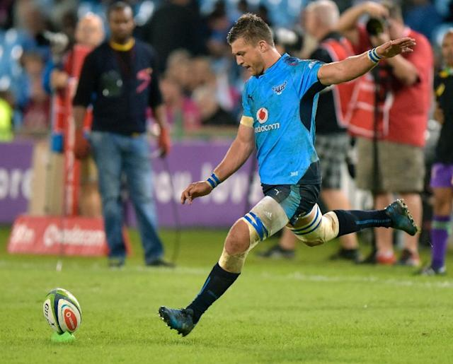 Handre Pollard of the Bulls kicks the ball during their match against the Argentinian Jaguares at the Loftus Rugby Stadium on April 15, 2017 in Pretoria (AFP Photo/CHRISTIAAN KOTZE)
