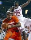Syracuse's DaJuan Coleman, left, is fouled by Arkansas' Jacorey Williams during the second half of an NCAA college basketball game in Fayetteville, Ark., Friday, Nov. 30, 2012. Syracuse won 91-82. (AP Photo/Gareth Patterson)