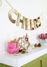 """<p>We love the versatility of this sequin garland. Use it over the bar on Christmas Eve, then pull it out for every special occasion throughout the year—birthday parties, weddings, showers... you name it. </p><p><a href=""""https://abeautifulmess.com/sequin-letter-garland-diy/"""" rel=""""nofollow noopener"""" target=""""_blank"""" data-ylk=""""slk:Get the tutorial."""" class=""""link rapid-noclick-resp"""">Get the tutorial.</a></p><p><a class=""""link rapid-noclick-resp"""" href=""""https://www.amazon.com/Sequin-Fabric-Yard-Tablecloth-Runner/dp/B00YANS9WE?tag=syn-yahoo-20&ascsubtag=%5Bartid%7C10072.g.37499128%5Bsrc%7Cyahoo-us"""" rel=""""nofollow noopener"""" target=""""_blank"""" data-ylk=""""slk:SHOP SEQUIN FABRIC"""">SHOP SEQUIN FABRIC</a></p>"""