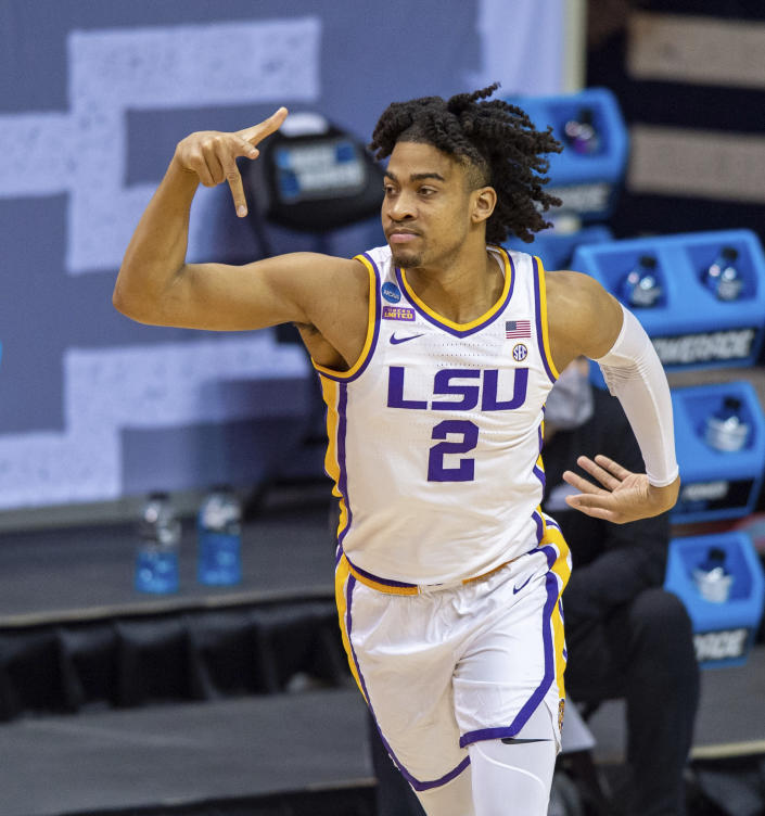 LSU forward Trendon Watford (2) reacts after scoring a 3-point basket during the first half of a first round game against St. Bonaventure in the NCAA men's college basketball tournament, Saturday, March 20, 2021, at Assembly Hall in Bloomington, Ind. (AP Photo/Doug McSchooler)
