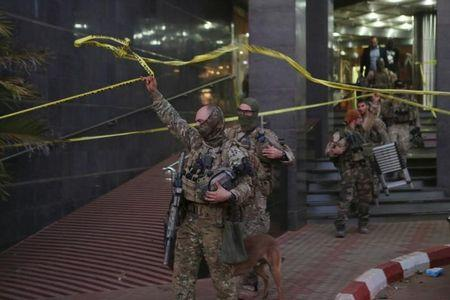 French soldiers leave the Radisson hotel in Bamako