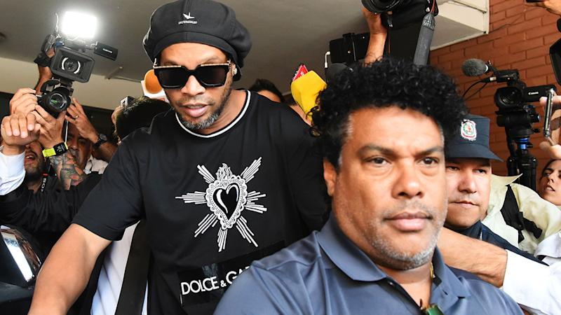 Ronaldinho, pictured here leaving Asuncion's Prosecution after being questioned by police.