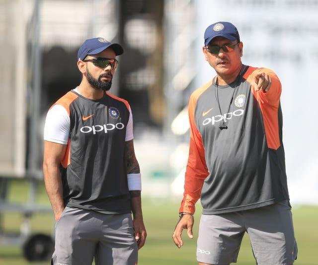 Virat Kohli, left, has announced he will stand down as India's Twenty20 captain at the end of their World Cup campaign (Adam Davy/PA)