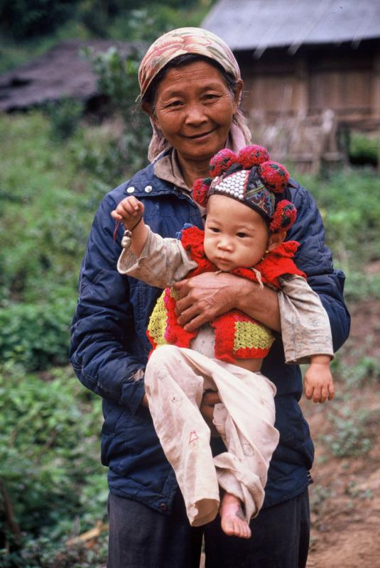 A woman and her baby from Tribal minority.  Xishuangbanna, China. Tribal minority.  Xishuangbanna, China.Tribal minority.  Xishuangbanna, China. © Charles Santiapillai/WWF-Cannon