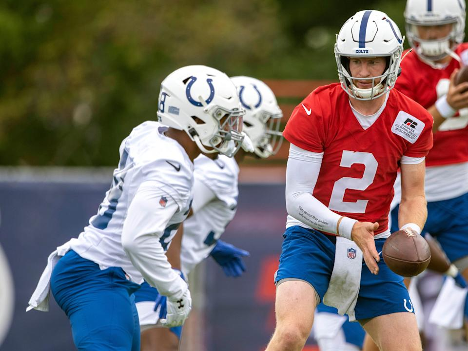 Colts QB Carson Wentz (2) gets ready to hand the ball off during a training camp session July 28.