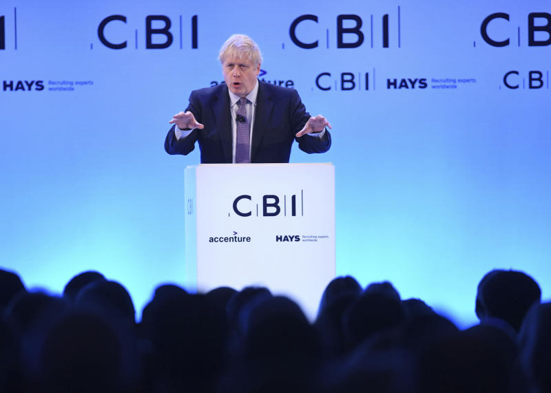 Prime Minister Boris Johnson speaks at the Confederation of British Industry (CBI) annual conference at the InterContinental Hotel in London, Monday, Nov. 18, 2019. The leaders of Britain's three biggest national political parties were making election pitches Monday to business leaders who are skeptical of politicians' promises after years of economic uncertainty over Brexit. (Stefan Rousseau/PA via AP)