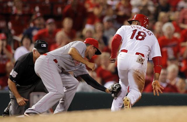Cincinnati Reds third baseman Kris Negron tags out St. Louis Cardinals' Oscar Taveras, right, as he attempts to advance on the play during the sixth inning of a baseball game Tuesday, Aug. 19, 2014, in St. Louis. (AP Photo/Scott Kane)