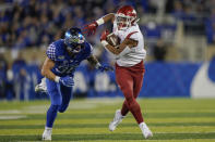 Arkansas running back Rakeem Boyd, right, is chased down by Kentucky linebacker Kash Daniel (56) during the first half of an NCAA college football game, Saturday, Oct. 12, 2019, in Lexington, Ky. (AP Photo/Bryan Woolston)