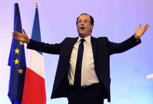 France's opposition Socialist Party (PS) candidate for the 2012 French Presidential election Francois Hollande waves on stage after the announcement of the estimated results of the first round of the French 2012 presidential election, on April 22, 2012 in Tulle, center France. Hollande won the first round