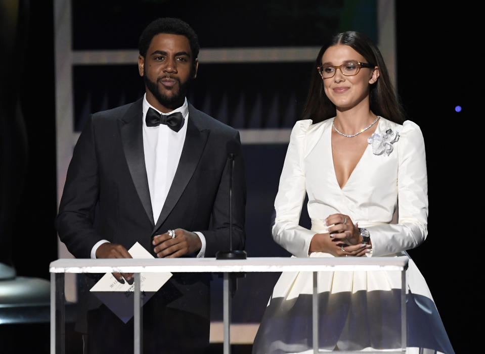 Jharrel Jerome and Millie Bobby Brown speak onstage during the 26th Annual Screen Actors Guild Awards at The Shrine Auditorium on January 19, 2020 in Los Angeles, California.