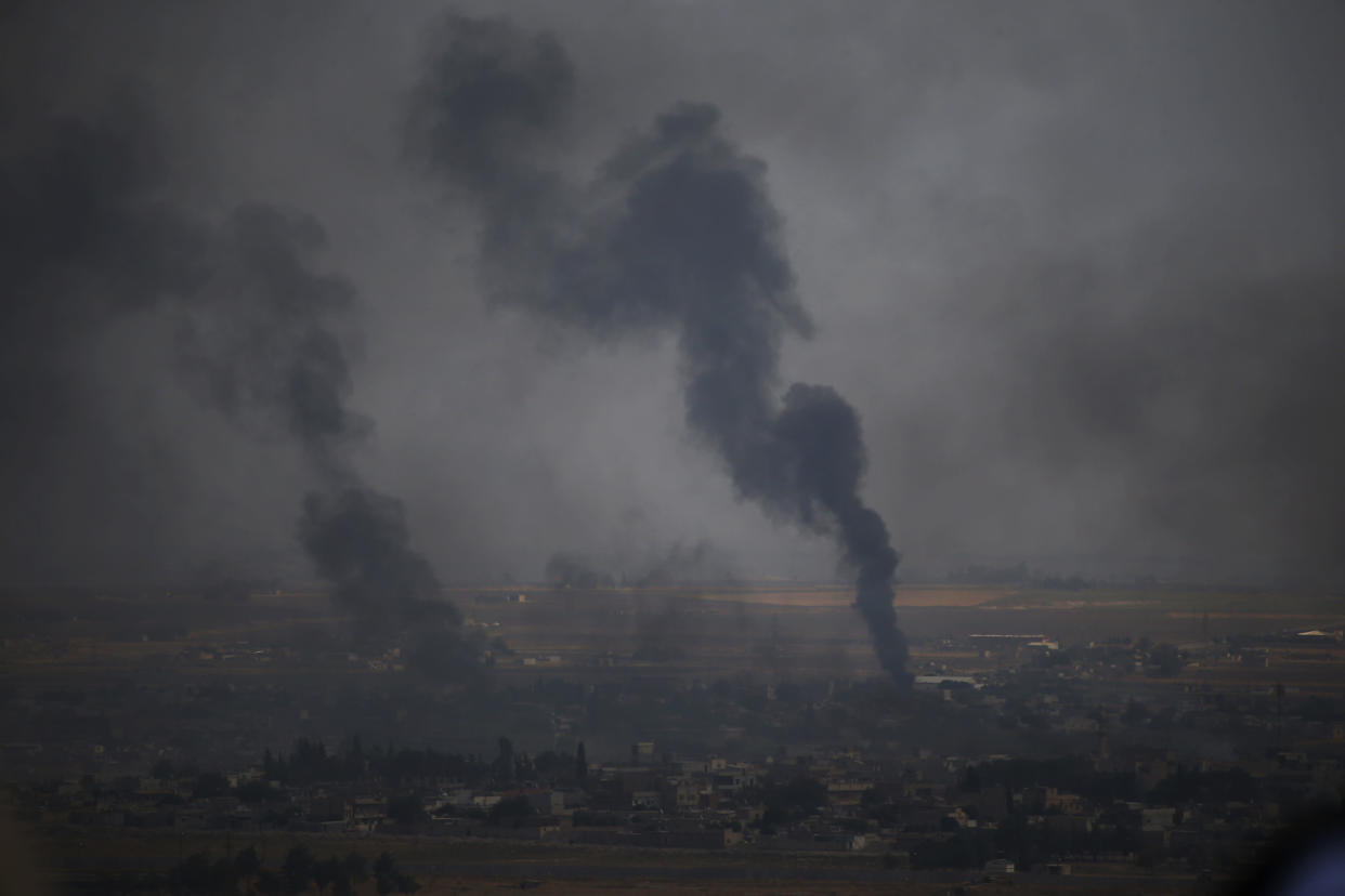 In this photo taken from the Turkish side of the border between Turkey and Syria, in Ceylanpinar, Sanliurfa province, southeastern Turkey, smoke billows from targets in Ras al-Ayn, Syria, during bombardment by Turkish forces, Oct. 16, 2019. (Photo: Lefteris Pitarakis/AP)