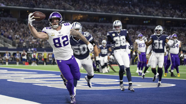 Minnesota Vikings tight end Kyle Rudolph (82) catches a first-quarter touchdown past next to Dallas Cowboys outside linebacker Sean Lee (50) during an NFL football game Sunday, Nov. 10, 2019, in Arlington, Texas. (Jerry Holt/Star Tribune via AP)