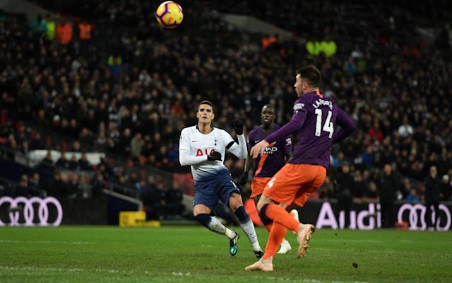 Erik Lamela skied the ball over the bar after it appeared to bobble before the Spurs midfielder hit it - Getty Images Europe