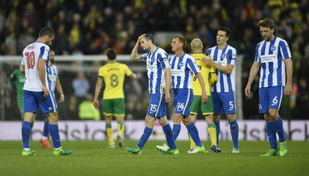 Britain Football Soccer - Norwich City v Brighton & Hove Albion - Sky Bet Championship - Carrow Road - 21/4/17 Brighton's Tomer Hemed, Jamie Murphy, Steve Sidwell and Dale Stephens look dejected after the match  Mandatory Credit: Action Images / Tony O'Brien