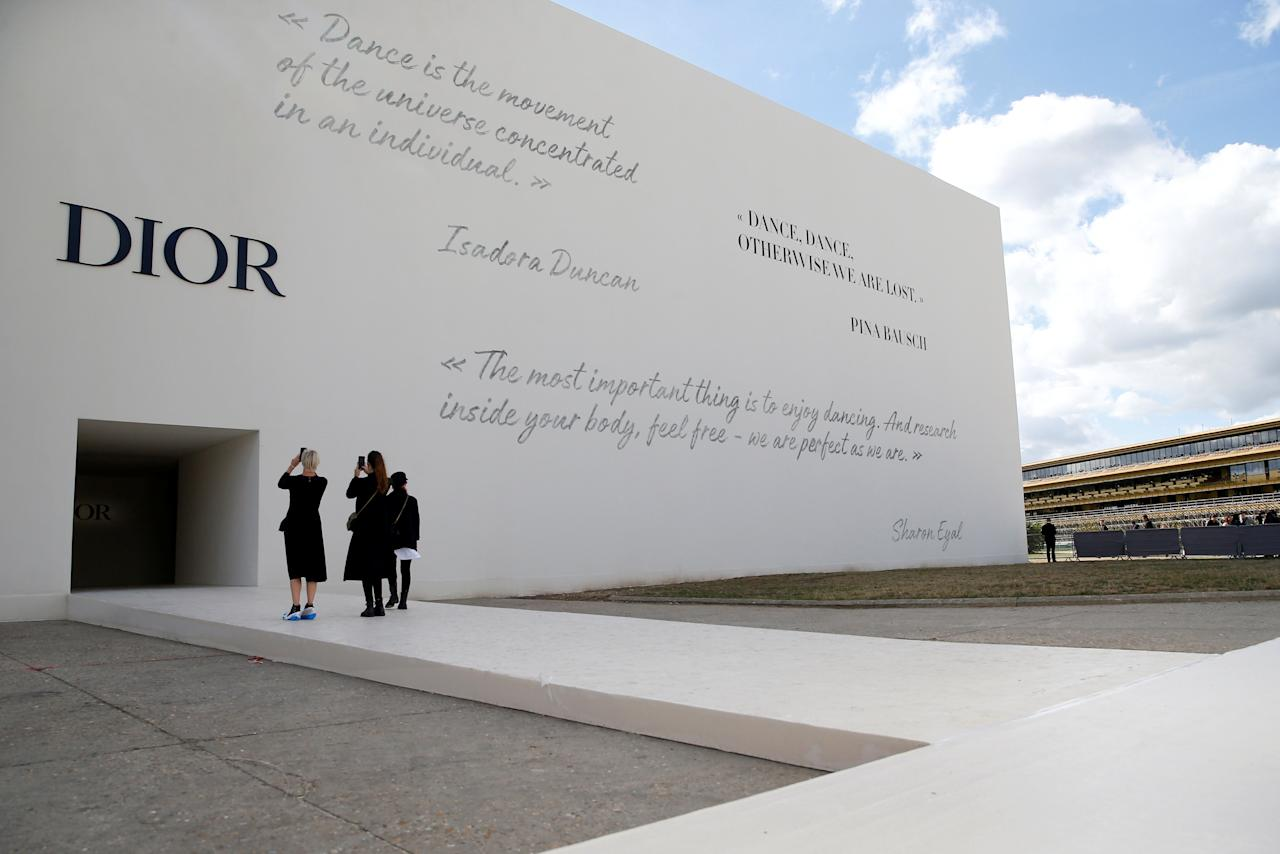 Guests take pictures in front of the venue for fashion house Dior Spring/Summer 2019 women's ready-to-wear collection show during Paris Fashion Week in Paris, France, September 24, 2018. REUTERS/Stephane Mahe