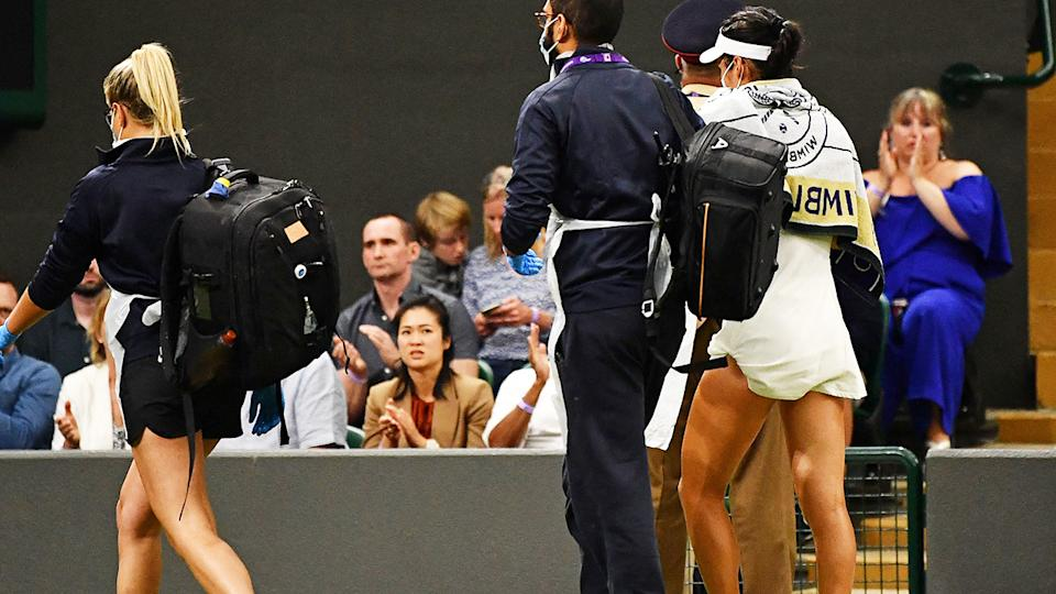 Emma Raducano, pictured here, leaves the field during her match against Agla Tomljanovic at Wimbledon.