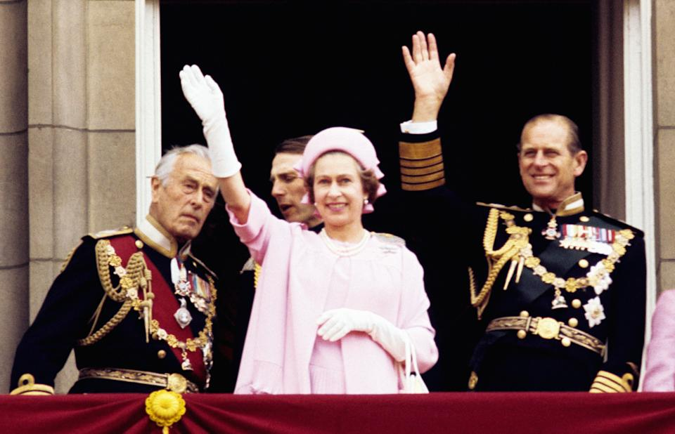 Left to right; Earl Mountbatten of Burma, Queen Elizabeth II and the Duke of Edinburgh wave from the balcony of Buckingham Palace after the Silver Jubilee procession.   (Photo by PA Images via Getty Images)