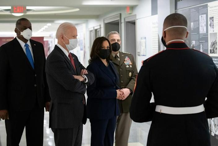 US President Joe Biden (2L), Vice President Kamala Harris (C), Chairman of the Joint Chiefs Mark Miller (2R) and Secretary of Defense Lloyd Austin (L) tour the African Americans in Service Corridor at the Pentagon in Washington, DC