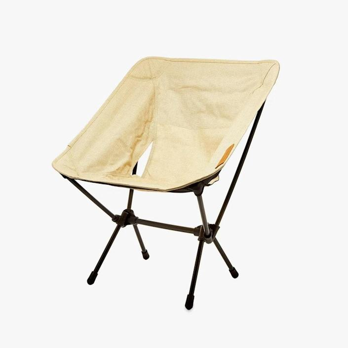 """$135, END CLOTHING. <a href=""""https://www.endclothing.com/us/helinox-home-chair-one-hel-10102-bg.html"""" rel=""""nofollow noopener"""" target=""""_blank"""" data-ylk=""""slk:Buy Now"""" class=""""link rapid-noclick-resp"""">Buy Now</a><br>"""