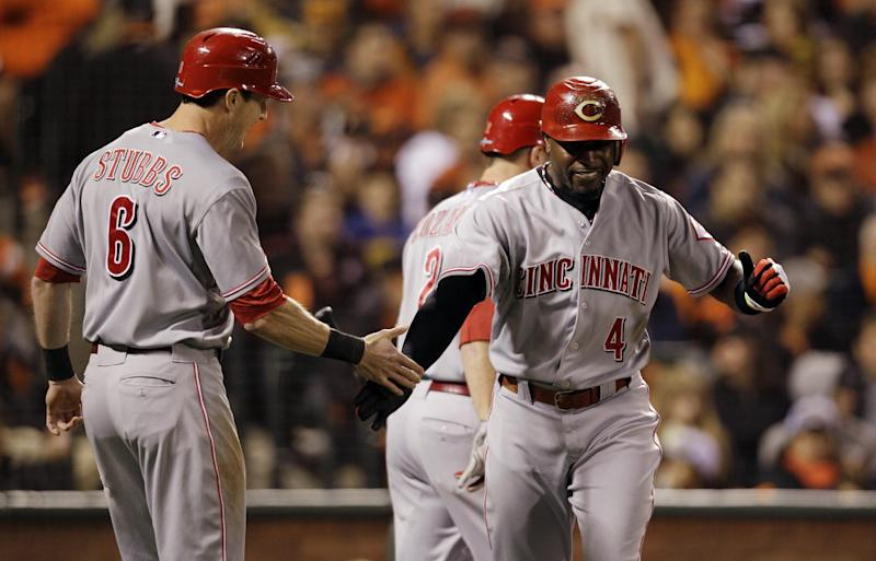 Cincinnati Reds' Brandon Phillips, right, gets congratulated by Drew Stubbs after Phillips hit a two-run home run in the third inning of Game 1 of the National League division baseball series against the San Francisco Giants in San Francisco, Saturday, Oct. 6, 2012. (AP Photo/Eric Risberg)