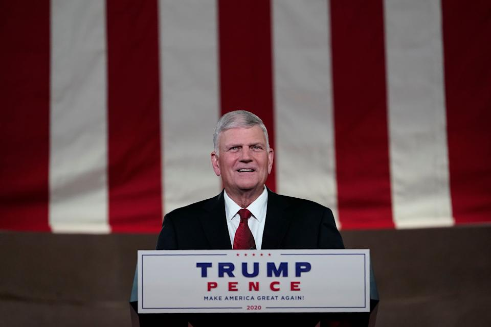 "Franklin Graham recites a prayer for the fourth day of the Republican National Convention on Aug. 27. Graham has defended Trump, saying he has never been ""a perfect person."" (Photo: Susan Walsh/Associated Press)"