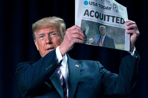 PHOTO: President Donald Trump holds up a newspaper with the headline that reads 'ACQUITTED' during the 68th annual National Prayer Breakfast, Feb. 6, 2020, in Washington, D.C. (Evan Vucci/AP)