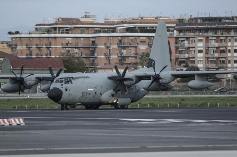 A C-130 plane carrying five Italian military members that were wounded last Sunday in northern Iraq as they returned from a mission aimed at helping Iraqi troops combat the Islamic State group, lands at the Ciampino military airport, near Rome, Wednesday, Nov. 13, 2019, 2019. (AP Photo/Andrew Medichini)