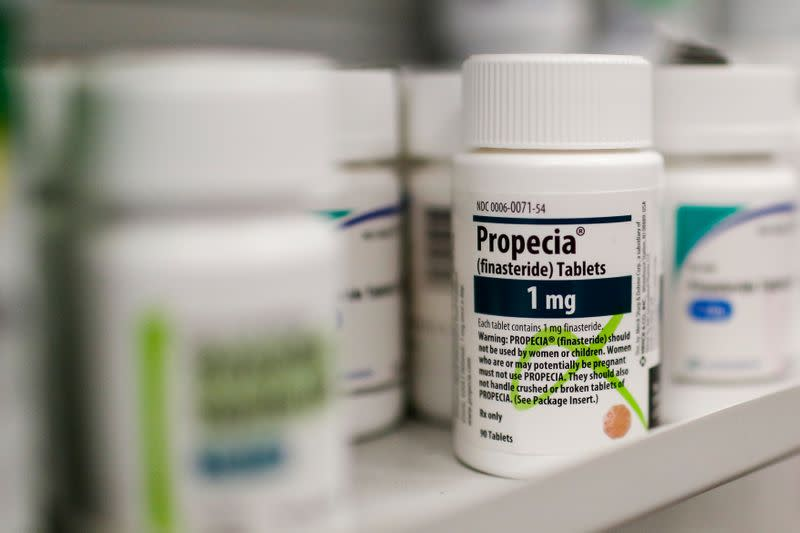 FILE PHOTO: A bottle of Propecia is seen on a pharmacy shelf in New York
