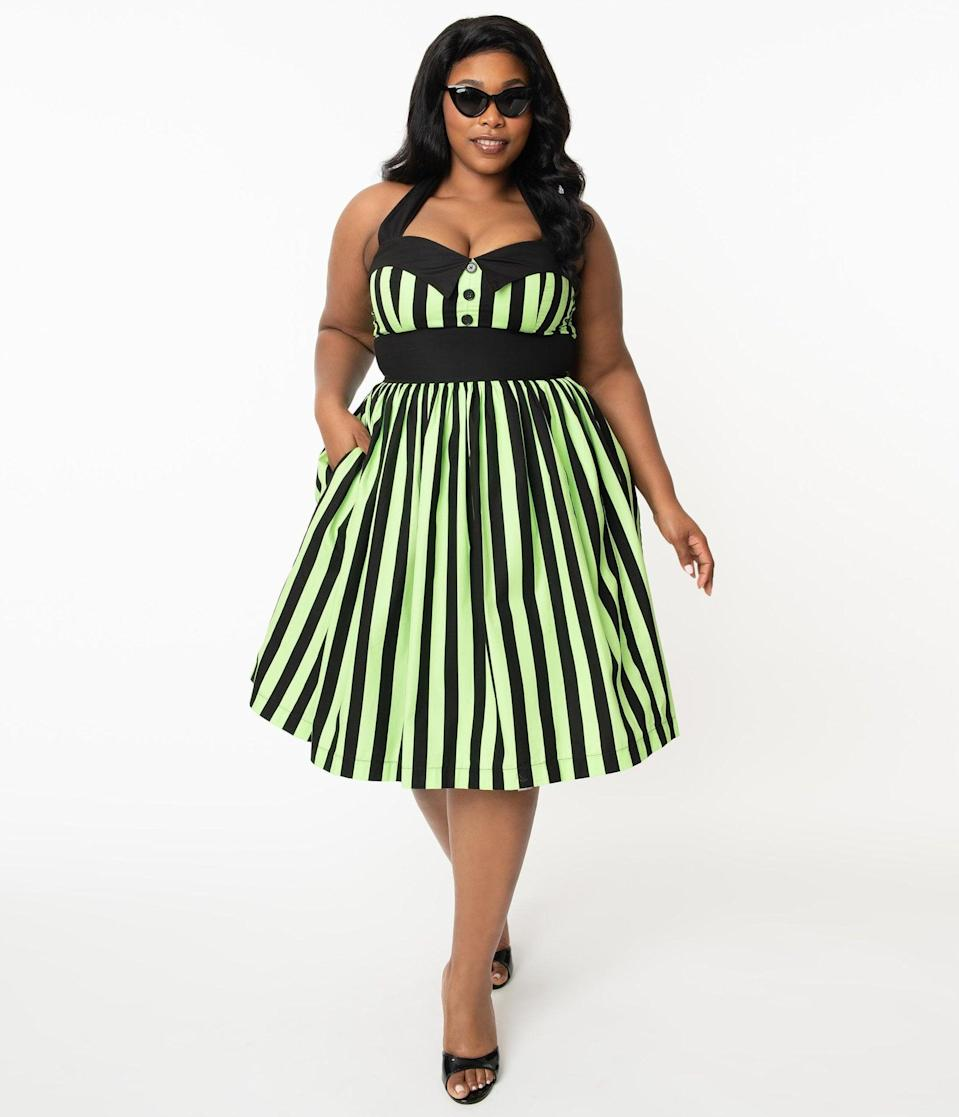 <p>You'll cast a spell on anyone who sees this <span>Plus Size 1950s Style Neon Green and Black Stripe Ashley Swing Dress</span> ($88).</p>