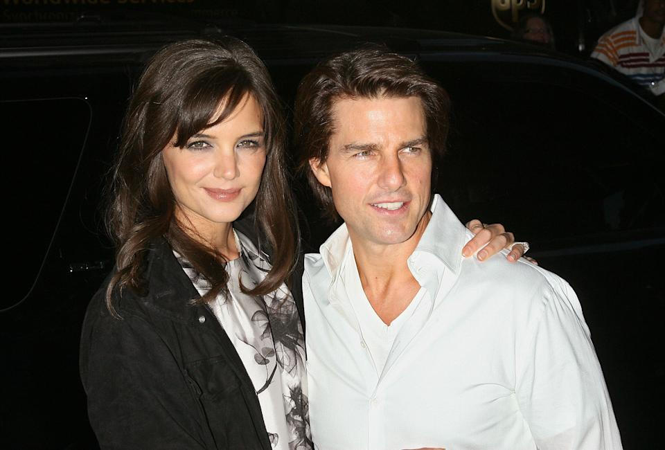 """NEW YORK - SEPTEMBER 07:  Actors Katie Holmes and Tom Cruise attend the Cinema Society with People StyleWatch & J. Crew screening of """"The Romantics"""" at AMC Loews 19th Street East 6 theater on September 7, 2010 in New York City.  (Photo by Jim Spellman/WireImage)"""