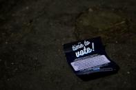 A voting flyer is seen on the ground at Philadelphia's City Hall, an early voting location for the upcoming presidential election, in Philadelphia, Pennsylvania