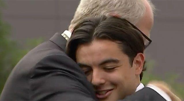 Mr Brown embraces a student as he returns to work. Source: 7 News