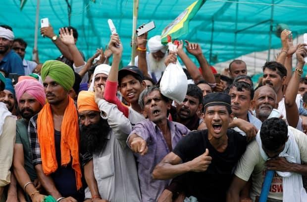 People shout slogans during a grand village council meeting as part of a farmers' protest against farm laws in Muzaffarnagar in the northern state of Uttar Pradesh, India, on Sept. 5, 2021. (Adnan Abidi/Reuters - image credit)