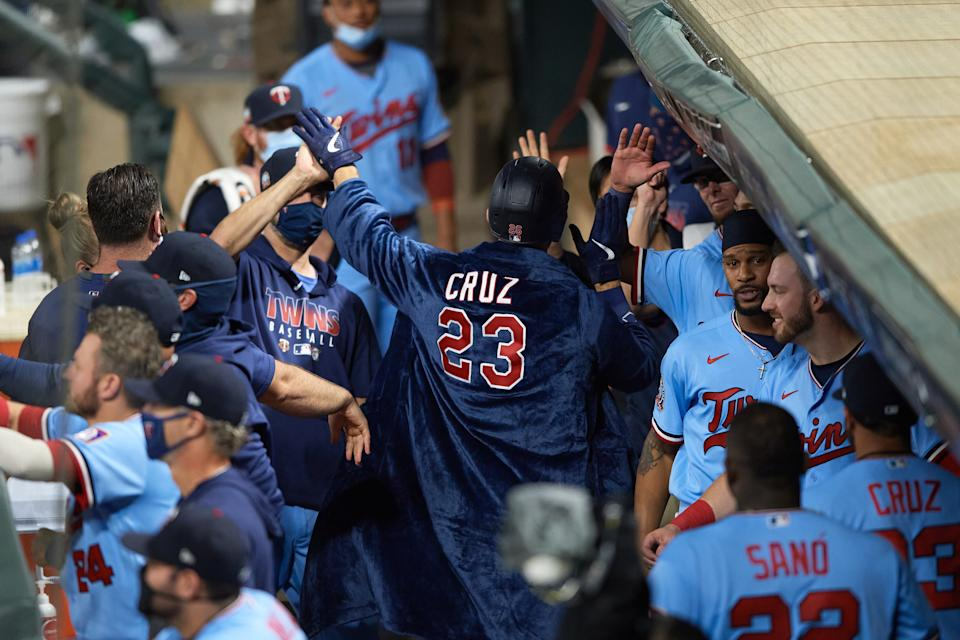 MINNEAPOLIS, MINNESOTA - SEPTEMBER 22: Max Kepler #26 of the Minnesota Twins wears a robe personalized for teammate Nelson Cruz #23 in the dugout after hitting a home run against the Detroit Tigers during the game at Target Field on September 22, 2020 in Minneapolis, Minnesota. The Twins defeated the Tigers 5-4 in ten innings. (Photo by Hannah Foslien/Getty Images)