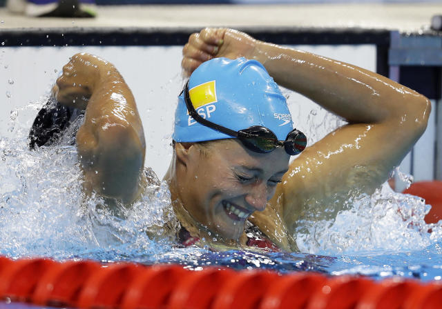 <p>Spain's Mireia Belmonte Garcia celebrates after winning the gold medal in the women's 200-meter butterfly final during the swimming competitions at the 2016 Summer Olympics, Wednesday, Aug. 10, 2016, in Rio de Janeiro, Brazil. (AP Photo/Michael Sohn) </p>