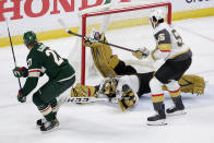Minnesota Wild center Nick Bjugstad (27) scores a goal on Vegas Golden Knights goaltender Marc-Andre Fleury (29) during the third period in Game 6 of an NHL hockey Stanley Cup first-round playoff series Wednesday, May 26, 2021, in St. Paul, Minn. The Wild won 3-0. (AP Photo/Andy Clayton-King)