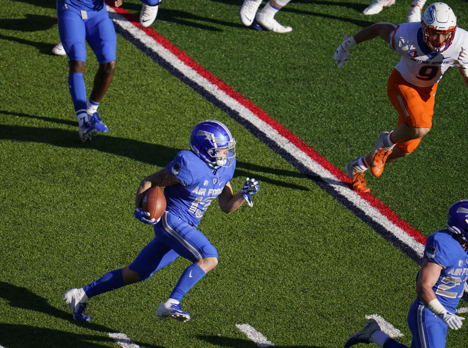 Air Force wide receiver Brandon Lewis carries the ball as Boise State linebacker Brock Miller pursues during the first half of an NCAA college football game Saturday Oct. 31, 2020, at Air Force Academy, Colo. (AP Photo/David Zalubowski)