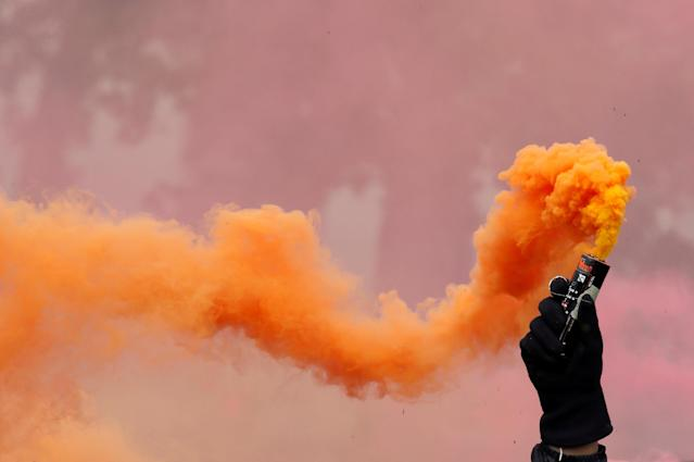 <p>A protester holds a smoke safety flare during the May Day labor union march in Paris, France, May 1, 2018. (Photo: Christian Hartmann/Reuters) </p>