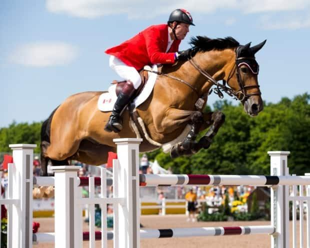 Saint-Jean, Que., native Mario Deslauriers went double clear with Bardolina 2 horse to capture the ATCO Queen Elizabeth II Cup at Spruce Meadows in Calgary on Saturday. (Cealy Tetley/@Equestrian_Can/Twitter - image credit)