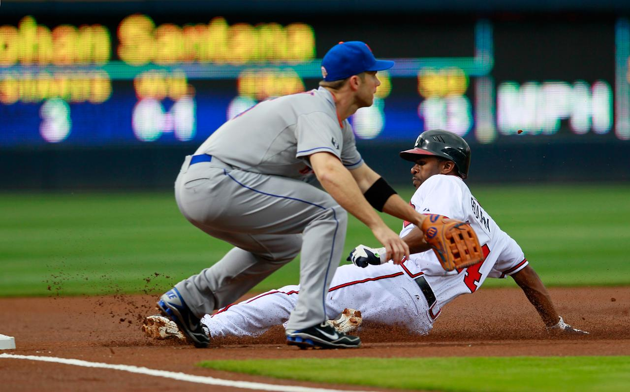 ATLANTA, GA - APRIL 17:  Michael Bourn #24 of the Atlanta Braves slides safely into third base against David Wright #5 of the New York Mets at Turner Field on April 17, 2012 in Atlanta, Georgia.  (Photo by Kevin C. Cox/Getty Images)