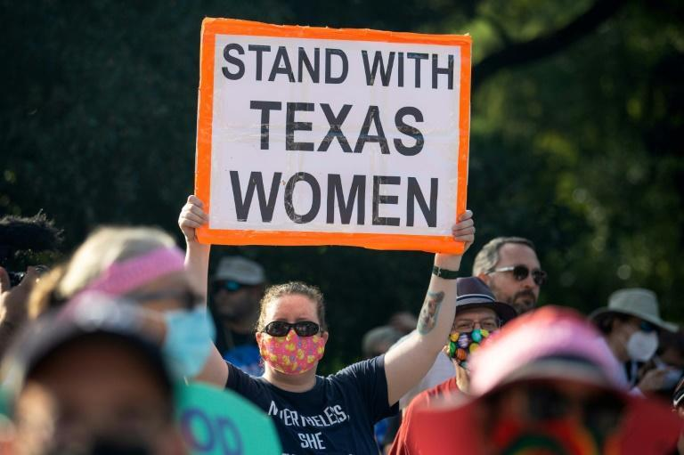 Demonstrators rally against anti-abortion and voter suppression laws at the Texas state capitol in Austin, on October 2, 2021 (AFP/Montinique Monroe)