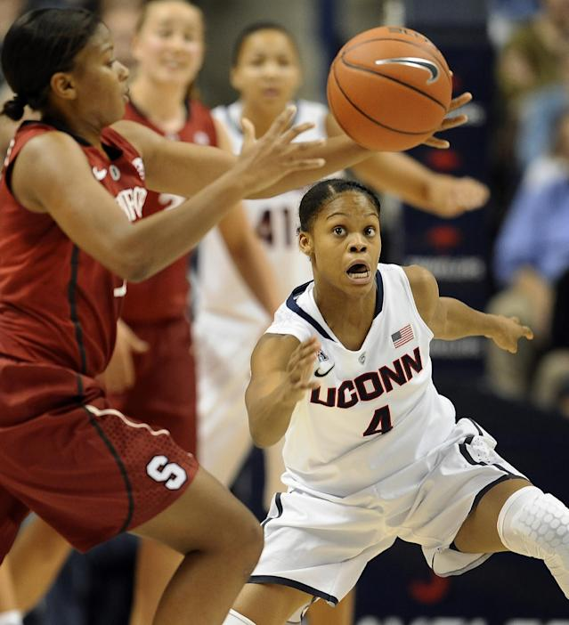 Connecticut's Moriah Jefferson, right, keeps an eye on the ball as Stanford's Amber Orrange, left, passes, during the first half of an NCAA college basketball game, Monday, Nov. 11, 2013, in Storrs, Conn. (AP Photo/Jessica Hill)