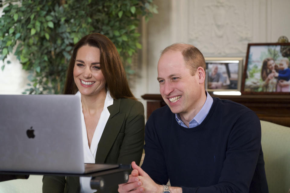 <p>Prince William and Kate, Duchess of Cambridge smile during a video call to people with health conditions about the positive impact of the COVID-19 vaccine. </p> (AP)