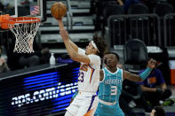 Phoenix Suns forward Cameron Johnson (23) shoots past Charlotte Hornets guard Terry Rozier (3) during the first half of an NBA basketball game, Wednesday, Feb. 24, 2021, in Phoenix. (AP Photo/Matt York)