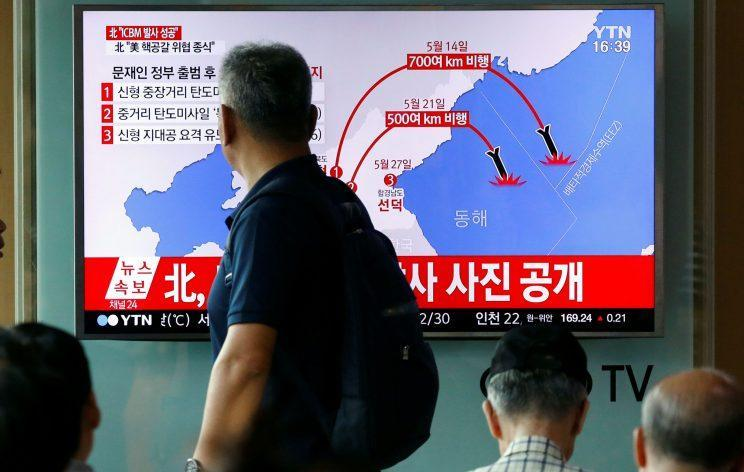 A man walks past a TV broadcasting a news report on the successful testing of North Korea Hwasong-14 missile (Photo: Kim Hong-Ji/Reuters)