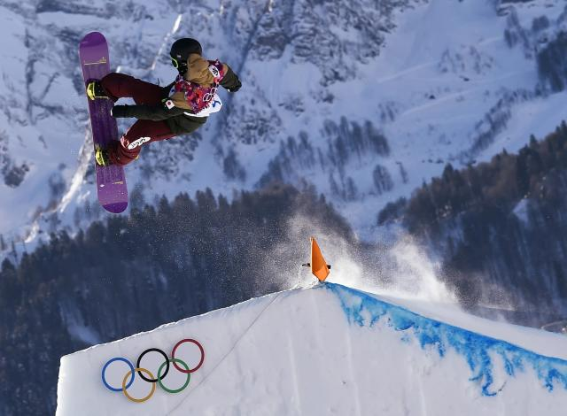 Japan's Yuki Kadono performs a jump during the men's snowboard slopestyle semi-final competition at the 2014 Sochi Olympic Games in Rosa Khuto r February 8, 2014. REUTERS/Dylan Martinez (RUSSIA - Tags: SPORT OLYMPICS SNOWBOARDING)