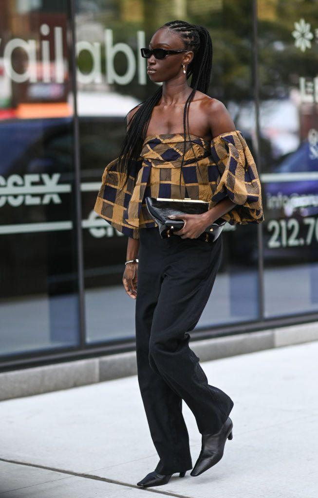 <p>This guest wore a Khaite plaid top with low heels. </p>