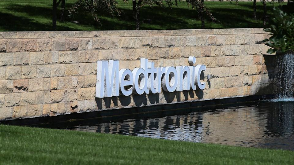 Mandatory Credit: Photo by Jim Mone/AP/Shutterstock (10474256a)The Medronic logo is reflected in a lake at the Minnesota headquarters in Fridley, Minn.