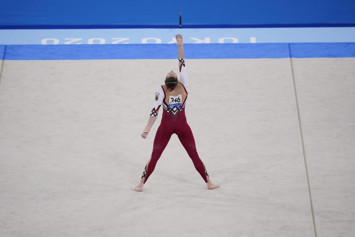 Sarah Voss, of Germany, performs her floor exercise routine during the women's artistic gymnastic qualifications at the 2020 Summer Olympics, Sunday, July 25, 2021, in Tokyo. (AP Photo/Gregory Bull)