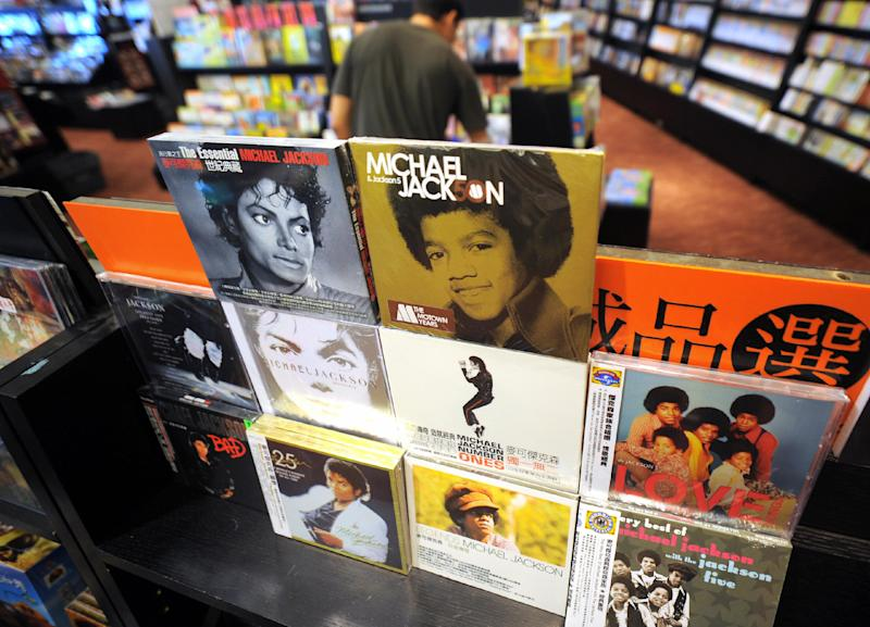 A man walks behind the Michael Jackson CD albums at a local book store in Taipei on June 26, 2009.